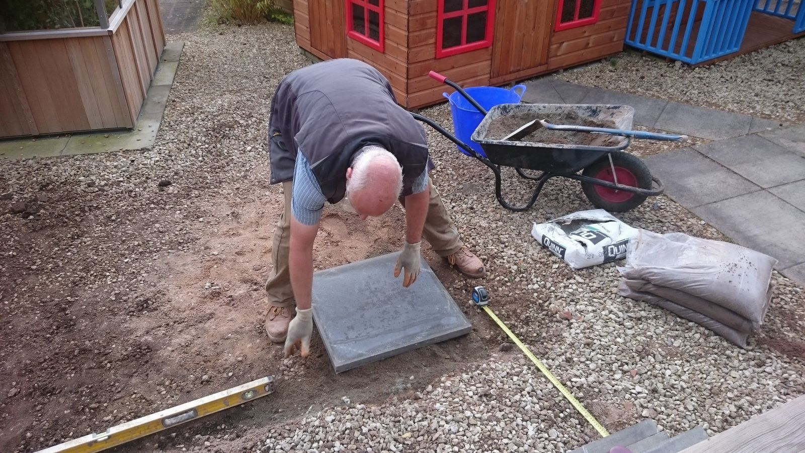 shed base area being laid with the first slab