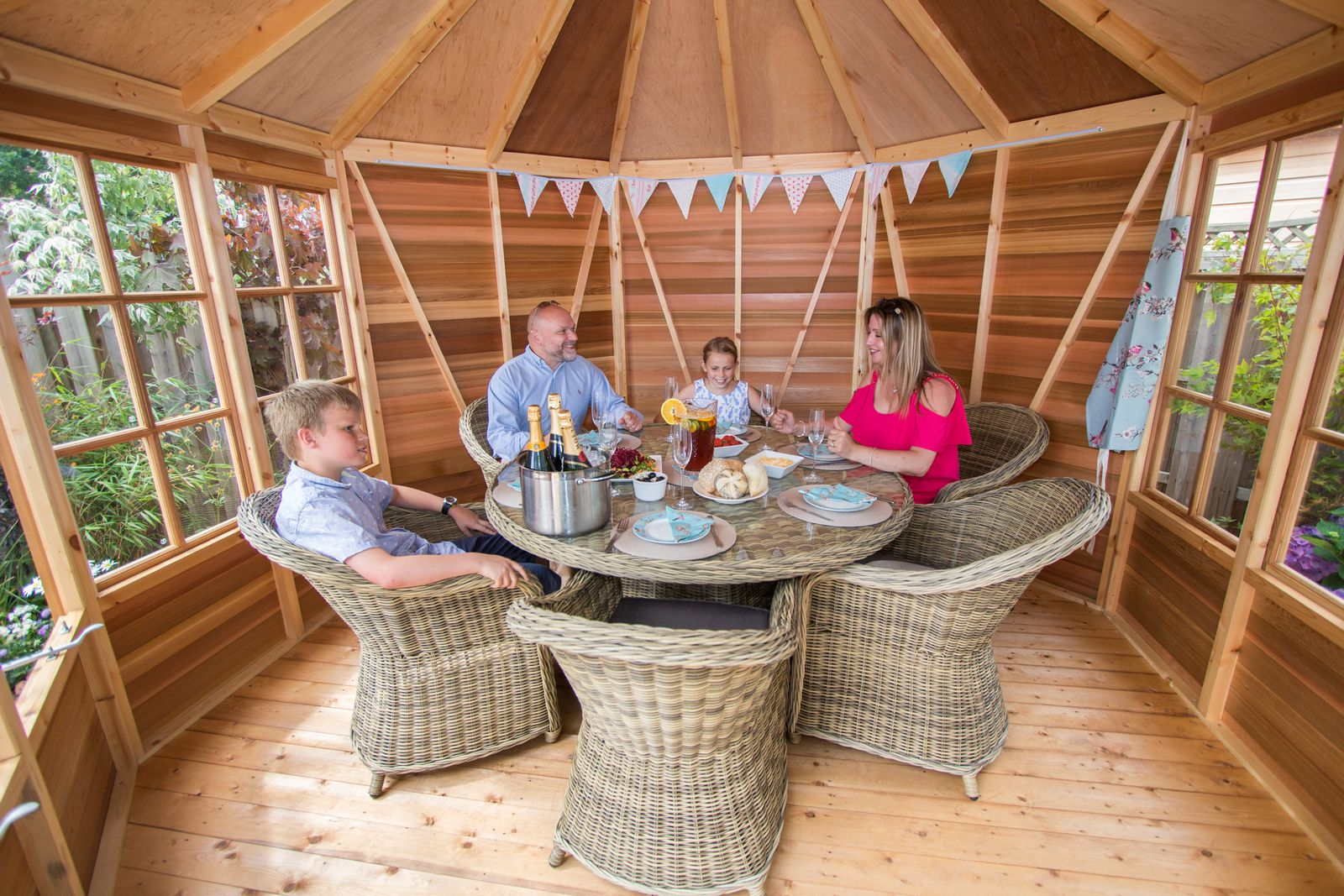 You could be relaxing with friends and family in a stylish summerhouse like this cedar summerhouse from Alton.